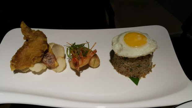 Special Sky 360 Fried Rice with seafood served with spicy chicken wing, fried egg and acar jelatah.